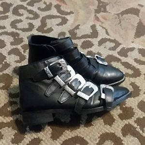 Black boots with silver buckles